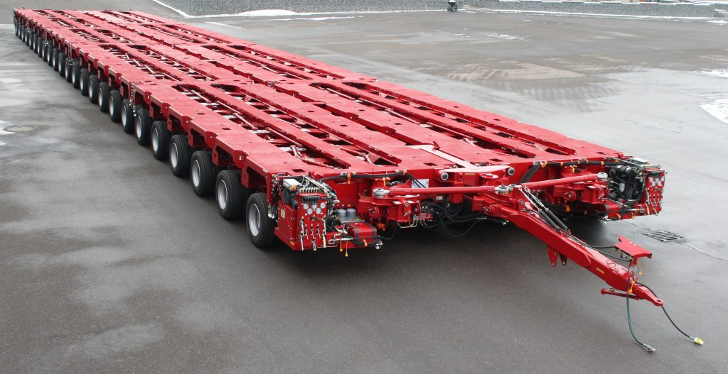 Multiple Hydraulic Trailer Modules combined lengthways and sideways to form 24 rows x 16 wheels in a row Trailer.