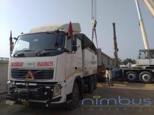 Bridge Girder Transported on Volvo 520 and Hydraulic Trailer