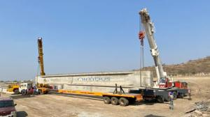 Bridge Girder being Transported on Telescopic High Bed Multiaxle Trailer